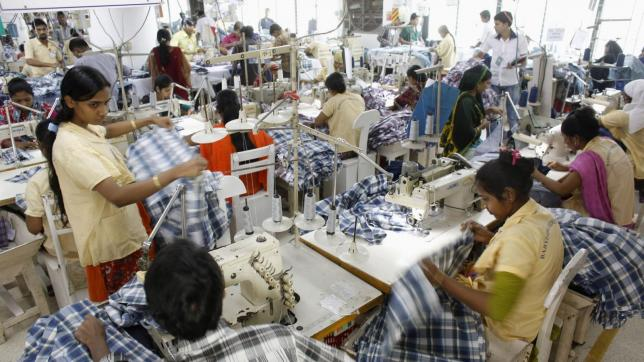 Employees work in a factory of Babylon Garments in Dhaka January 3, 2014. On the outskirts of Dhaka, Babylon Garments has shortened work shifts to eight hours from the usual 10 and plans to shutter production lines as months of election-related violence disrupts transport and prompts global retailers to curb orders. Picture taken January 3, 2014.  To match BANGLADESH-GARMENTS/  REUTERS/Andrew Biraj (BANGLADESH - Tags: BUSINESS EMPLOYMENT TEXTILE)